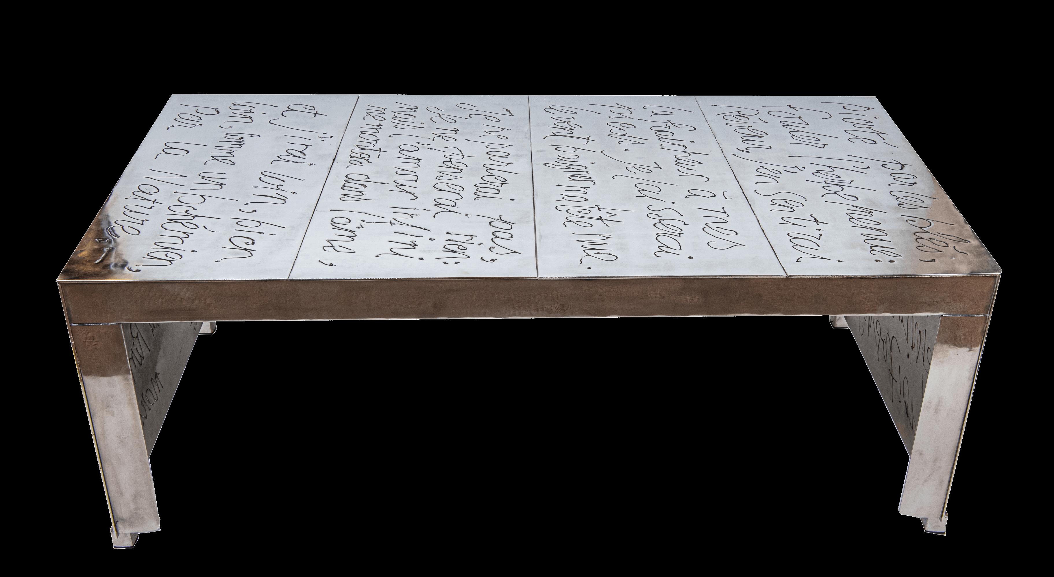 Table basse acier nickelé 1100€